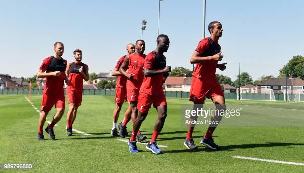 Ragnar Klavan Daniel Sturridge Joel Matip Adam Lallana Naby Keita and Fabinho of Liverpool during their first day back for preseason training at...