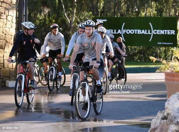 Ragnar Klavan Dejan Lovren Joe Gomez and Georginio Wijnaldum of Liverpool arrives on a bike before a training session at Marbella Football Center on...