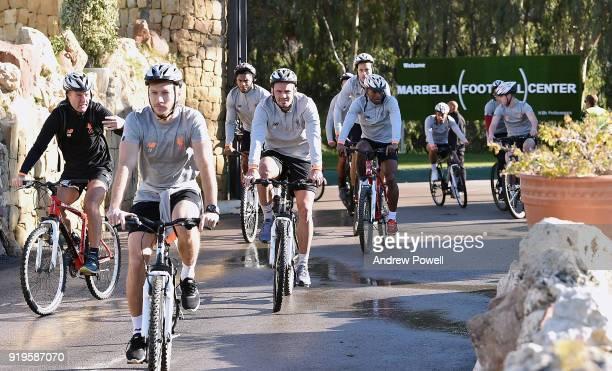 Ragnar Klavan Dejan Lovren Joe Gomez Georginio Wijnaldum and Virgil van Dijk of Liverpool arrive on a bike before a training session at Marbella...
