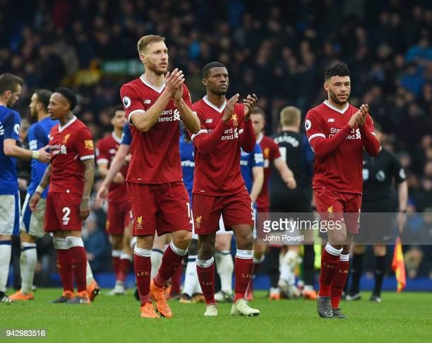 Ragnar Klavan Georginio Wijnaldum and Alex OxladeChamberlain of Liverpool shows his appreciation to the fans at the end of the Premier League match...