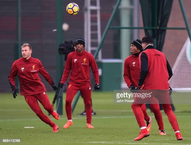 Ragnar Klavan Georginio WijnaldumDaniel Sturridge and Emre Can of Liverpool during a training session at Melwood Training Ground on December 8 2017...