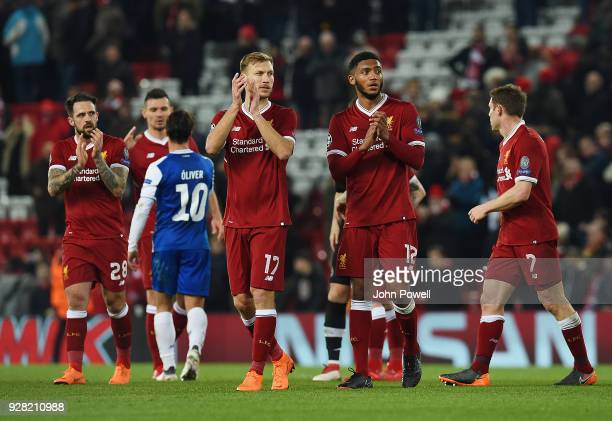 Ragnar Klavan Joe Gomez and Danny Ings of Liverpool showing his appreciation to the fans at the end of the UEFA Champions League Round of 16 Second...