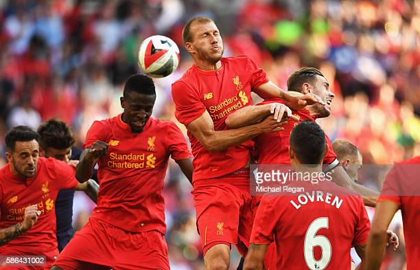 Ragnar Klavan Jordan Henderson and Divock Origi of Liverpool attempt to win the ball during the International Champions Cup match between Liverpool...