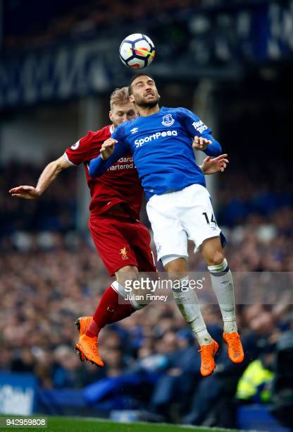 Ragnar Klavan of Liverpool and Cenk Tosun of Everton battle for the header during the Premier League match between Everton and Liverpool at Goodison...