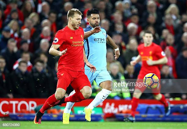 Ragnar Klavan of Liverpool and Sergio Aguero of Manchester City in action during the Premier League match between Liverpool and Manchester City at...