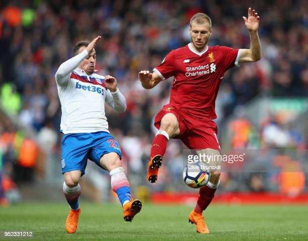 Ragnar Klavan of Liverpool and Xherdan Shaqiri of Stoke City in action during the Premier League match between Liverpool and Stoke City at Anfield on...
