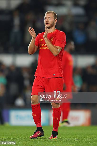 Ragnar Klavan of Liverpool applauds supporters during the EFL Cup Third Round match between Derby County and Liverpool at iPro Stadium on September...