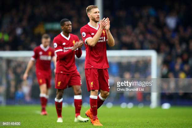 Ragnar Klavan of Liverpool applauds the supporters following the Premier League match between Everton and Liverpool at Goodison Park on April 7 2018...