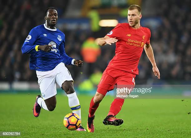 Ragnar Klavan of Liverpool beats Romelu Lukaku of Everton to the ball during the Premier League match between Everton and Liverpool at Goodison Park...