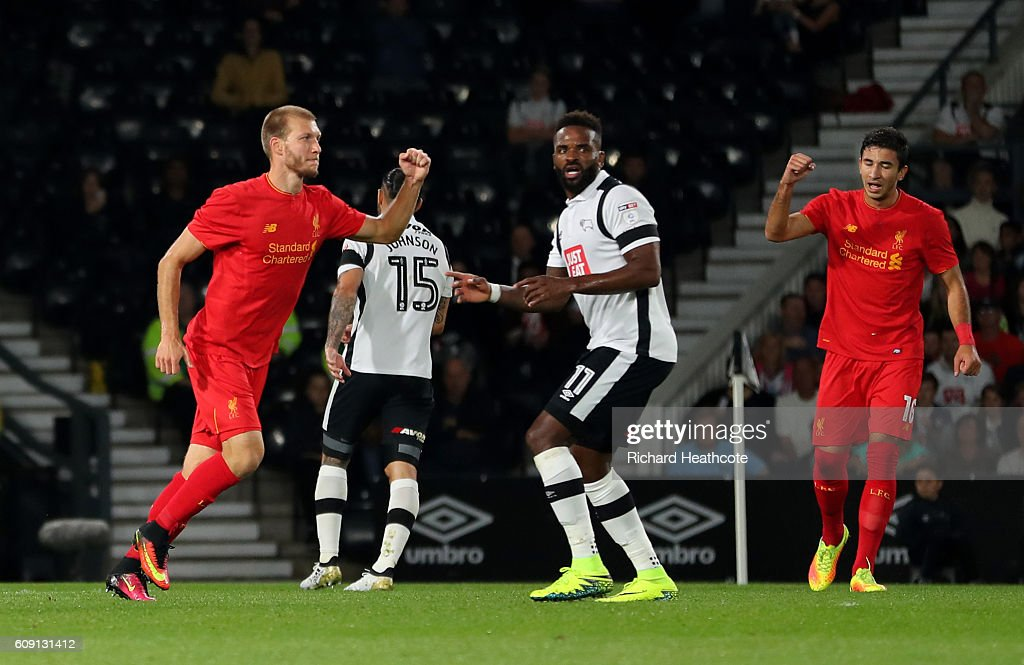 Ragnar Klavan (L) of Liverpool celebrates scoring the opening goal during the EFL Cup Third Round match between Derby County and Liverpool at iPro Stadium on September 20, 2016 in Derby, England.