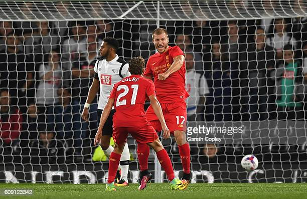 Ragnar Klavan of Liverpool celebrates scoring the opening goal with Lucas Leiva during the EFL Cup Third Round match between Derby County and...