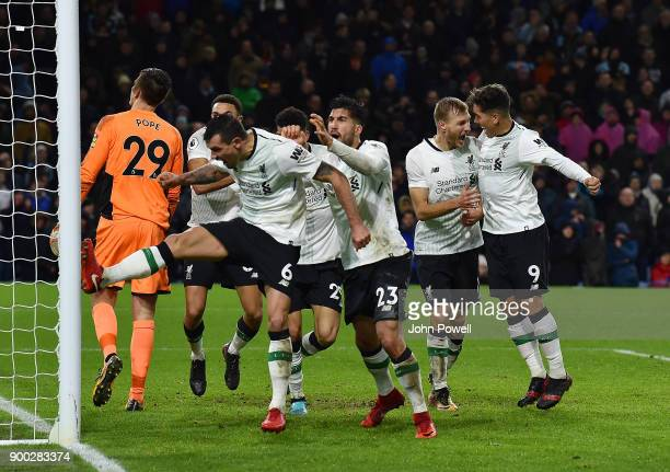 Ragnar Klavan of Liverpool celebrates with his team mates after scoring the winning goal during the Premier League match between Burnley and...