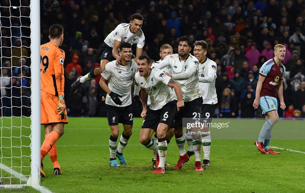 Ragnar Klavan of Liverpool celebrates with his team mates after scoring the winning goal during the Premier League match between Burnley and Liverpool at Turf Moor on January 1, 2018 in Burnley, England.
