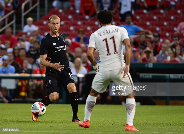 Ragnar Klavan of Liverpool FC battle for the ball with Mohamed Salah of AS Roma during a friendly match at Busch Stadium on August 1 2016 in St Louis...