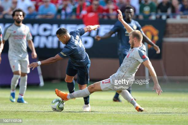 Ragnar Klavan of Liverpool goes to steal the ball from Alexi Sanchez of Manchester United during an International Champions Cup match between...