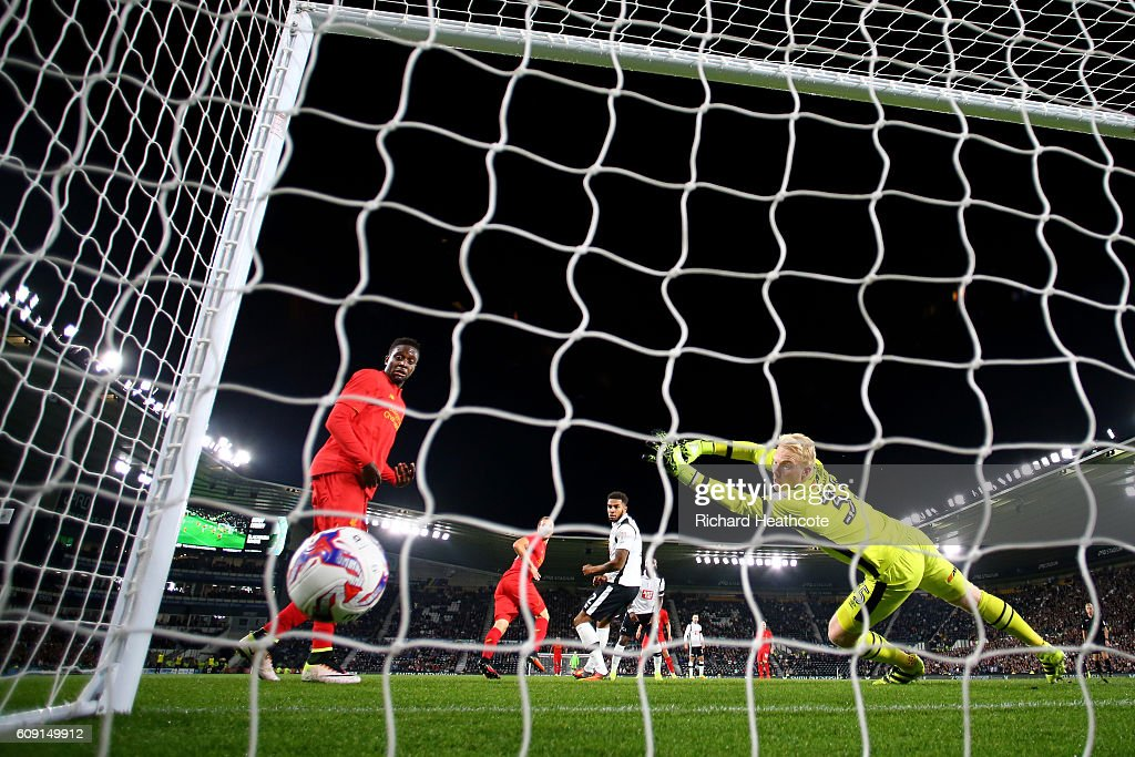 Ragnar Klavan of Liverpool scores the opening goal past Jonathan Mitchell of Derby County during the EFL Cup Third Round match between Derby County and Liverpool at iPro Stadium on September 20, 2016 in Derby, England.