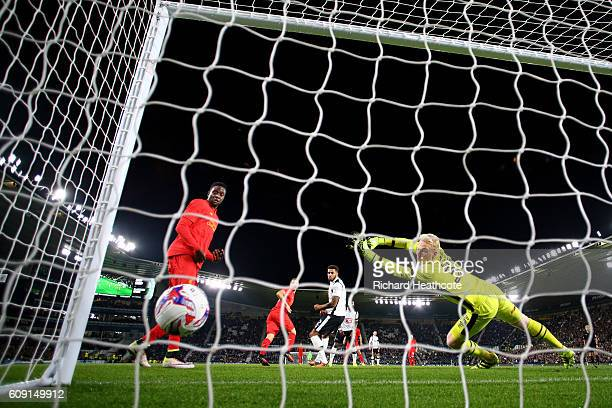 Ragnar Klavan of Liverpool scores the opening goal past Jonathan Mitchell of Derby County during the EFL Cup Third Round match between Derby County...
