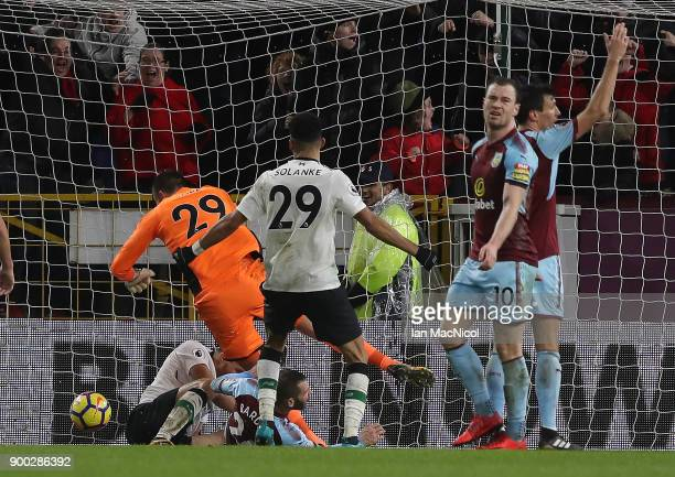 Ragnar Klavan of Liverpool scores the winning goal during the Premier League match between Burnley and Liverpool at Turf Moor on January 1 2018 in...