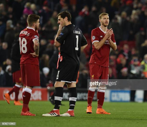 Ragnar Klavan of Liverpool showing his appreciation to the fans at the end of the UEFA Champions League Round of 16 Second Leg match between...