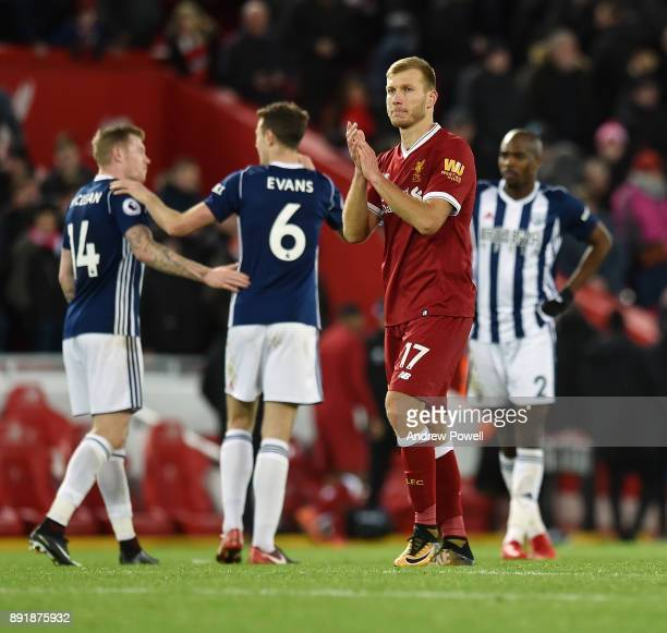 Ragnar Klavan of Liverpool shows his appreciation to the fans at the end of the Premier League match between Liverpool and West Bromwich Albion at...