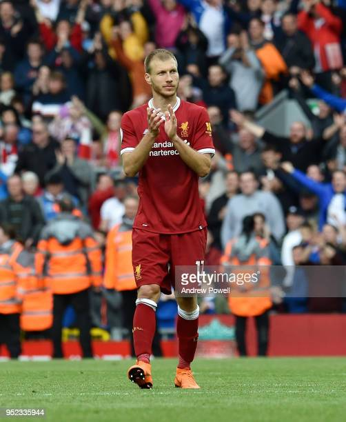 Ragnar Klavan of Liverpool shows his appreciation to the fans at the end of the Premier League match between Liverpool and Stoke City at Anfield on...