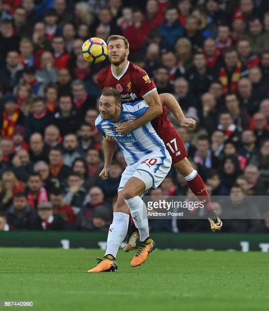 Ragnar Klavan of Liverpool with Laurent Depoitre of Huddersfield during the Premier League match between Liverpool and Huddersfield Town at Anfield...