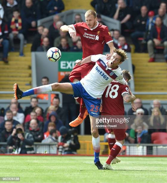 Ragnar Klavan of Liverpool with Peter Crouch of Stoke City during the Premier League match between Liverpool and Stoke City at Anfield on April 28...