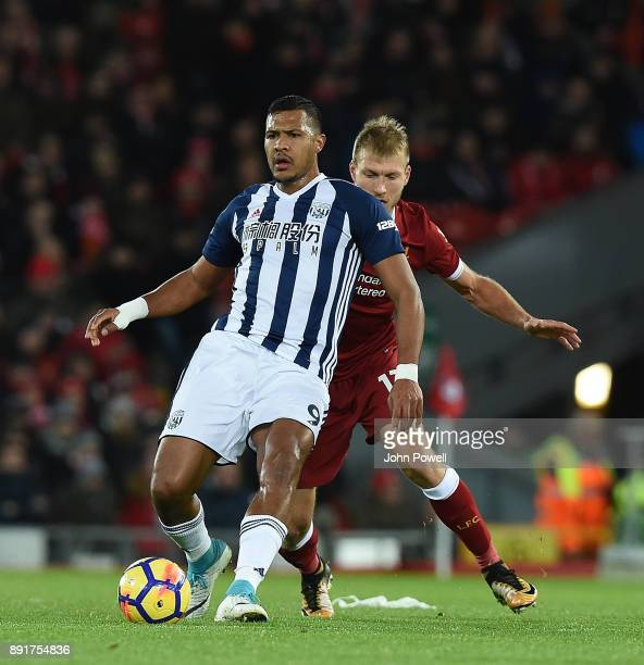 Ragnar KLavan of Liverpool with Salomon Rondon during the Premier League match between Liverpool and West Bromwich Albion at Anfield on December 13...