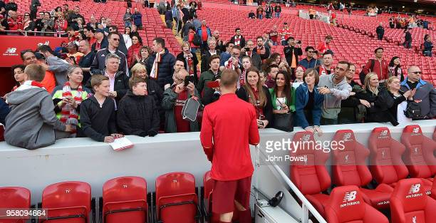 Ragnar Klavan of Liverpool with some fans at the end of the Premier League match between Liverpool and Brighton and Hove Albion at Anfield on May 13...