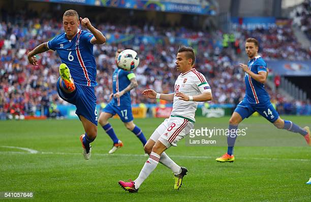 Ragnar Sigurdsson of Iceland and Adam Nagy of Hungary compete for the ball during the UEFA EURO 2016 Group F match between Iceland and Hungary at...