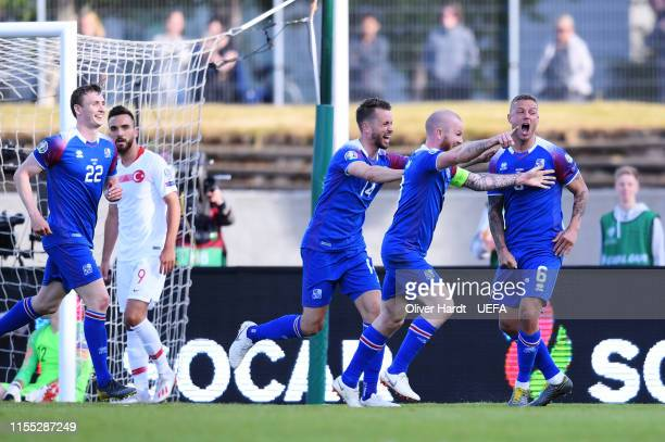 Ragnar Sigurdsson of Iceland celebrates after scoring his team's first goal during the UEFA Euro 2020 Qualifier match between Iceland and Turkey at...