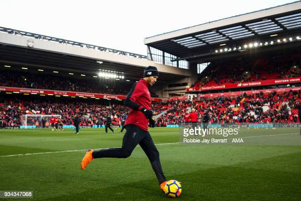 Ragner Klavan of Liverpool warms up prior to the Premier League match between Liverpool and Watford at Anfield on March 17 2018 in Liverpool England