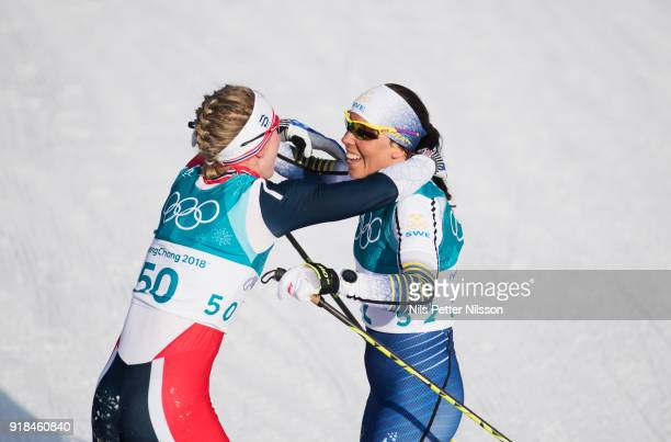 Ragnhild Haga of Norway and Charlotte Kalla of Sweden hugs during the women's 10k free technique Cross Country competition at Alpensia CrossCountry...