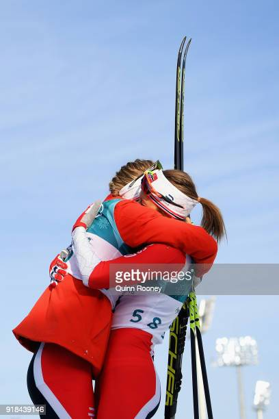 Ragnhild Haga of Norway celebrates in the finish area with Ingvild Flugstad Oestberg of Norway after winning the CrossCountry Skiing Ladies' 10 km...