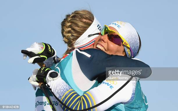 Ragnhild Haga of Norway celebrates with Charlotte Kalla of Sweden following the CrossCountry Skiing Ladies' 10 km Free on day six of the PyeongChang...