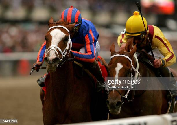 Rags to Riches riden by John Velzquez crosses the finish line ahead of Curlin riden by Robby Albarado during the 139th Belmont Stakes June 9 2007 at...
