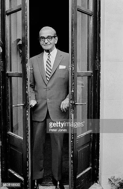Ragtime composer Irving Berlin standing in doorway
