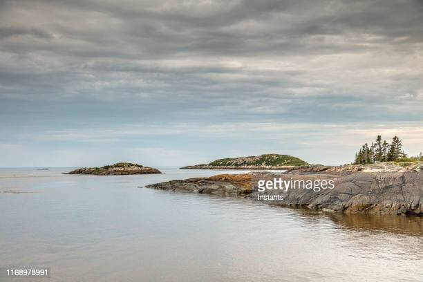 ragueneau archipelago with its small islands on quebec north coast, north coast, as seen from the dock. - north stock pictures, royalty-free photos & images