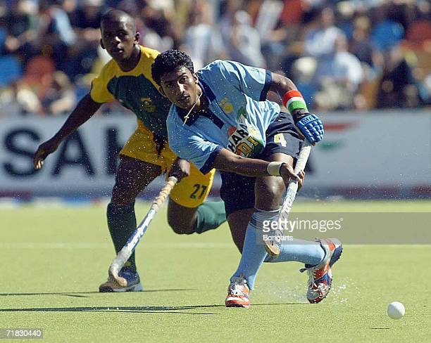 Ragunath Vakkaliga of India passes the ball as Lungile Tsolekile looks on during the World Cup Match between South Africa and India at the Warsteiner...