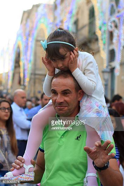 ragusa ibla, sicily: father and daughter at saint day celebration - fingers in ears stock pictures, royalty-free photos & images