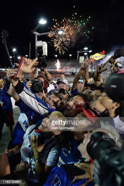 Rahal Letterman Lanigan Racing Honda driver Takuma Sato celebrates with a selfie after winning the NTT IndyCar Series Bommarito Automotive Group 500...
