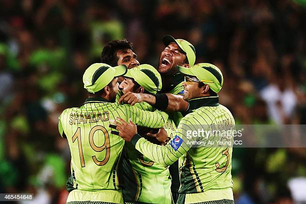 Rahat Ali of Pakistan is mobbed by his teammates after taking the wicket of David Miller of South Africa during the 2015 ICC Cricket World Cup match...