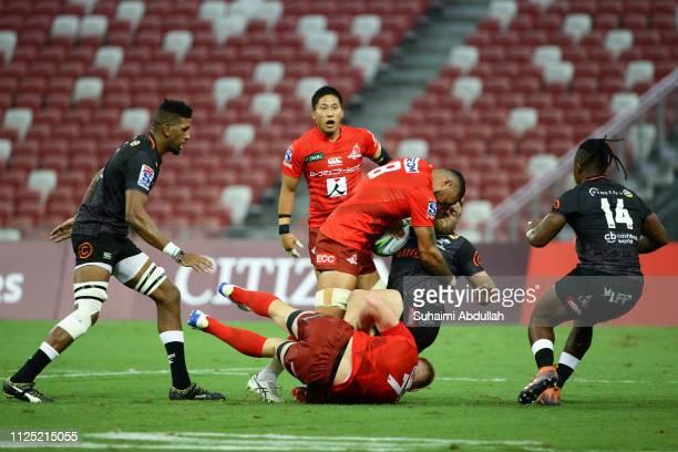 Rahboni Warren Vosayaco of Sunwolves tackles Akker van der Merwe of Sharks during the Super Rugby match between Sunwolves and Sharks at Singapore...