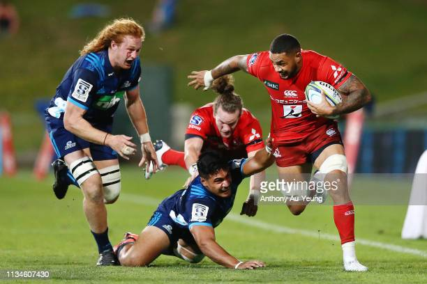 Rahboni Warren-Vosayaco of the Sunwolves makes a break against Tanielu Tele'a of the Blues during the round 4 Super Rugby match between the Blues and...