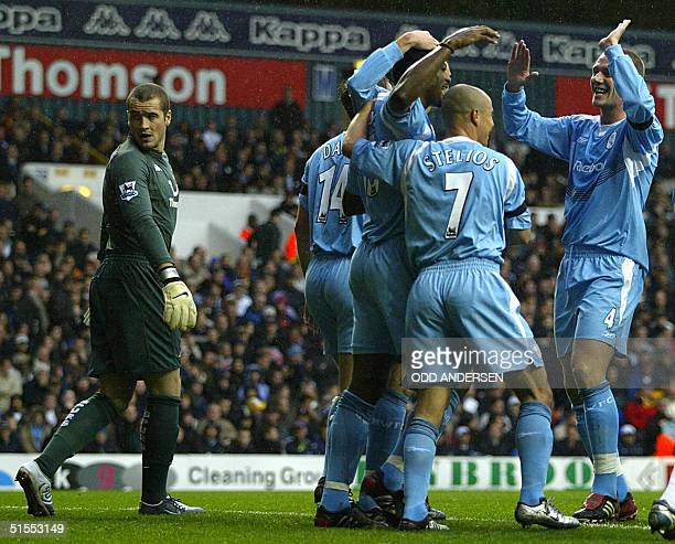 Rahdi Jaidi of Bolton and teammates celebrate his opening goal as Tottenham keeper Paul Robinson watches the ball in the net during their premiership...