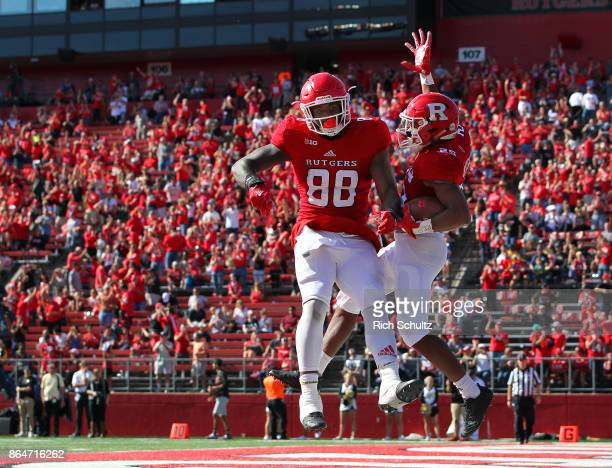 Raheem Blackshear of the Rutgers Scarlet Knights celebrates his 35 yard touchdown with Nixon Provillon against the Purdue Boilermakers during the...