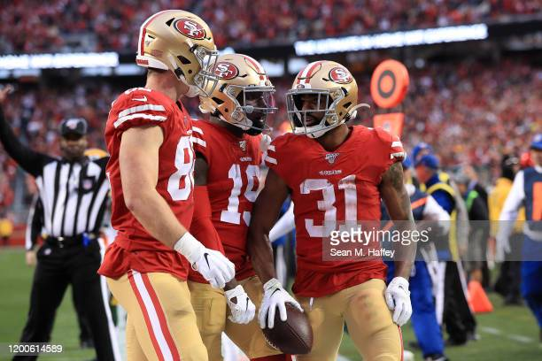 Raheem Mostert celebrates a touchdown in the second quarter against the Green Bay Packers during the NFC Championship game at Levi's Stadium on...