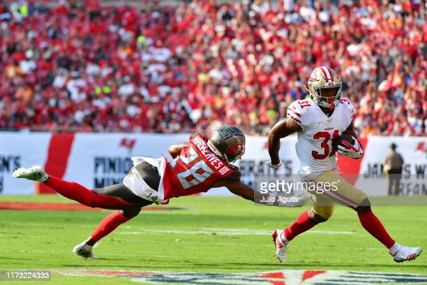 Raheem Mostert of the San Francisco 49ers breaks a tackle from Vernon Hargreaves III of the Tampa Bay Buccaneers in the second quarter of a football...