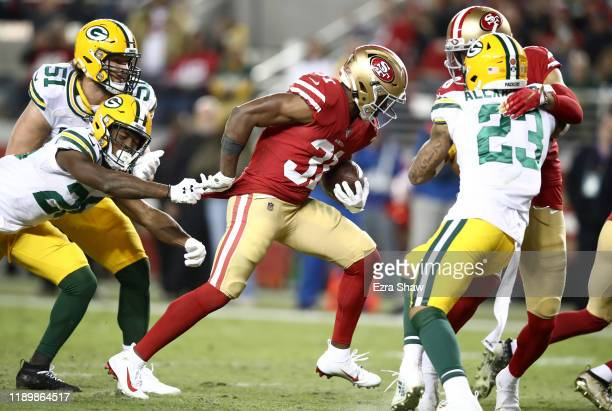 Raheem Mostert of the San Francisco 49ers breaks away from Darnell Savage of the Green Bay Packers on his way to a touchdown at Levi's Stadium on...