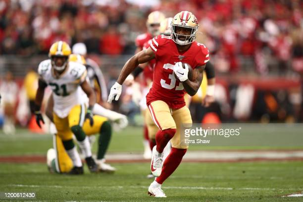 Raheem Mostert of the San Francisco 49ers breaks away to run for a touchdown in the first quarter against the Green Bay Packers during the NFC...